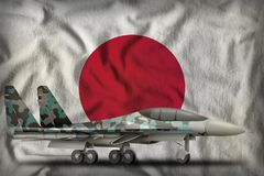 Fighter, interceptor with winter camouflage on the Japan state flag background. 3d Illustration. Fighter, interceptor with winter camouflage on the Japan flag Stock Photos
