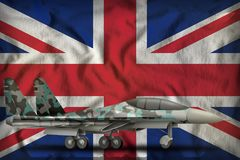 Fighter, interceptor with winter camouflage on the United Kingdom UK state flag background. 3d Illustration. Fighter, interceptor with winter camouflage on the Royalty Free Stock Image