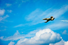 Fighter Jet. Small jet airplane flying in blue sky Stock Images