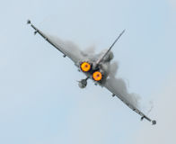 Fighter jet afterburners. Fighter jet with afterburners puling high G and fluffing up, Eurofighter Typhoon Stock Images