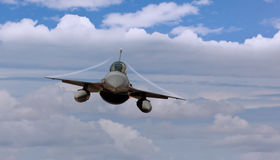 Fighter jet airborne with contrails. In the wings Stock Photography