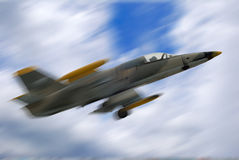Fighter jet airplane in motion. Military fighter jet airplane in motion on blue sky background royalty free stock photography