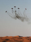 Fighter jet display team at airshow. Fast jets perform at an airshow in Al Ain, United Arab Emirates. Flying over the desert stock photo