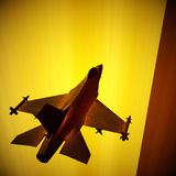 Fighter jet flying against a blue sky, 3d illustration Royalty Free Stock Photos