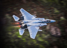 Fighter jet in full reheat afterburners Royalty Free Stock Photography