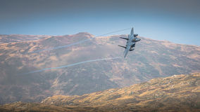 Fighter Jet landscape. Fighter jet creating ribbons over Iraq mountain desert  style landscape Royalty Free Stock Images