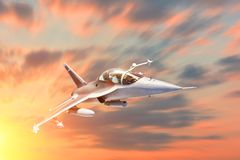 Fighter jet military speed maneuver in flight airforce base on sunset time. Fighter jet military speed maneuver in flight airforce base on sunset time stock photo