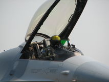 Fighter Jet Pilot. A pilot of a fighter jet inside the cockpit, getting ready for takeoff Royalty Free Stock Photography