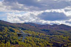 Fighter jet and scottish hills. The queens view Stock Image