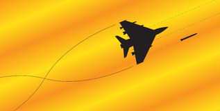 Fighter Jet Silhouette Fighting. A fighter jet silhouette firing all weapons on a colourful background Royalty Free Stock Image