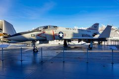 Fighter Jet on Aircraft Carrier. Fighter jets on showcase on an aircraft carrier at mid-day stock photography