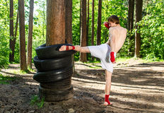 Fighter kicking rubber wheels Stock Photography