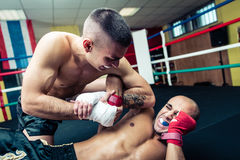 Fighter makes submission and arm lock. At the ground stock images