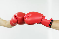 Fighter man punching with red boxing gloves. Boxing practicing Stock Photos