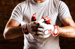 Fighter. Mma fighter is getting ready against brick wall Stock Image