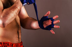 Fighter. Mma fighter is getting ready on gray background Royalty Free Stock Photo