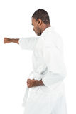 Fighter performing karate stance Royalty Free Stock Images