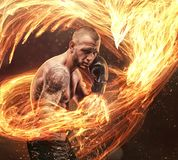 Fighter with phoenix fire bird on background. Fighter`s burning punch with phoenix fire bird on background royalty free stock photography