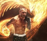 Fighter with phoenix fire bird on background. Fighter`s burning punch with phoenix fire bird on background royalty free stock images