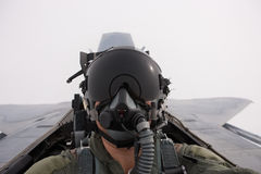 A fighter pilot in his aircraft. Stock Photo