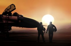Fighter pilot on military airbase during sunset. Fighter pilot and supersonic jet on military airbase during sunset Royalty Free Stock Photo