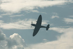Fighter plane on cloudy sky Stock Photography