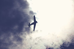 Fighter plane on cloudy sky Stock Photos