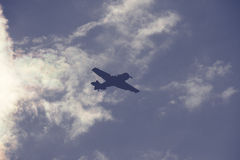 Fighter plane on cloudy sky Royalty Free Stock Photography