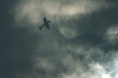 Fighter plane on cloudy sky Royalty Free Stock Photo