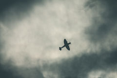 Fighter plane on cloudy sky Royalty Free Stock Photos