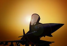 Fighter Plane on the Ground. At Sunset Royalty Free Stock Photos