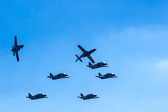 Fighter plane looping in turbo fly on the sky Stock Photos