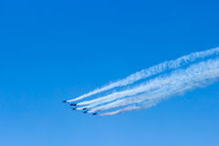 Fighter plane looping in turbo fly on the sky Royalty Free Stock Images