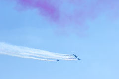 Fighter plane looping in turbo fly on the sky Stock Images