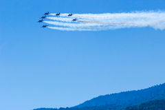 Fighter plane looping in turbo fly on the sky Royalty Free Stock Photos