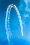 Fighter plane looping in turbo fly on the sky Stock Photography