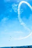 Fighter plane looping in turbo fly on the sky makes heart Royalty Free Stock Images