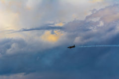 Fighter plane over the clouds Stock Photos