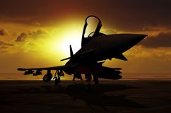 Fighter plane at sunset on carrier ship Stock Photos