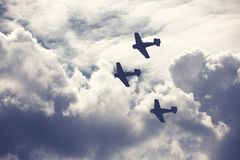 Fighter planes on cloudy sky Royalty Free Stock Image