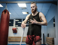 Fighter preparing for training, wrapping hands with boxing wraps Royalty Free Stock Photography