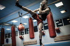 Fighter shadowboxing at gym Stock Images