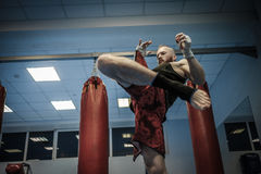 Fighter shadowboxing at gym Stock Photos