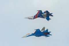 Fighter Sukhoi Su-27 show aerobatics at an airshow Russian Knights. Stock Images