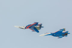 Fighter Sukhoi Su-27 show aerobatics at an airshow Russian Knights. Royalty Free Stock Image