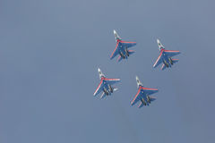 Fighter Sukhoi Su-27 show aerobatics at an airshow Russian Knights. Royalty Free Stock Photography