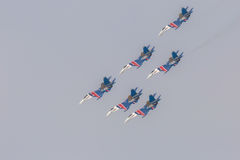 Fighter Sukhoi Su-27 show aerobatics at an airshow Russian Knights. Stock Photography