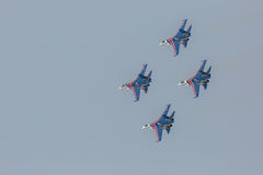 Fighter Sukhoi Su-27 show aerobatics at an airshow Russian Knights. Stock Photo