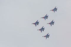 Fighter Sukhoi Su-27 show aerobatics at an airshow Russian Knights. Stock Image
