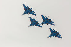 Fighter Sukhoi Su-27 show aerobatics at an airshow Russian Knights. Stock Photos